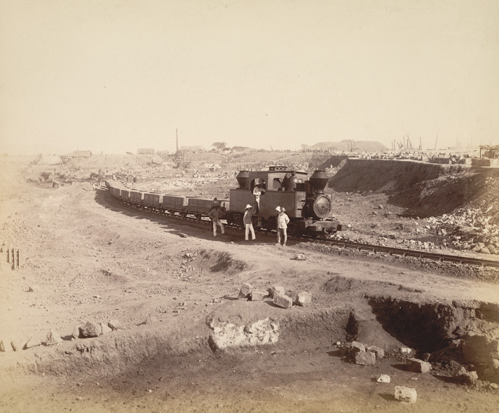 Main line looking down gullet from N.W. corner, south jetty [Victoria Dock construction, Bombay].